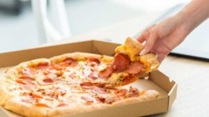 How to keep pizza from sticking to stone